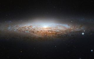 我国天文学家发现由重子物质主导的奇特矮星系